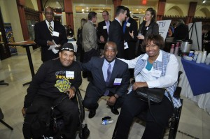 RTA CEO Michael Ford (center) with Warriors on Wheels members Larry Dilworth (left) and Lisa Franklin (right)