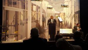 Michael Ford introduced the Regional Transit Master Plan to a packed crowd.