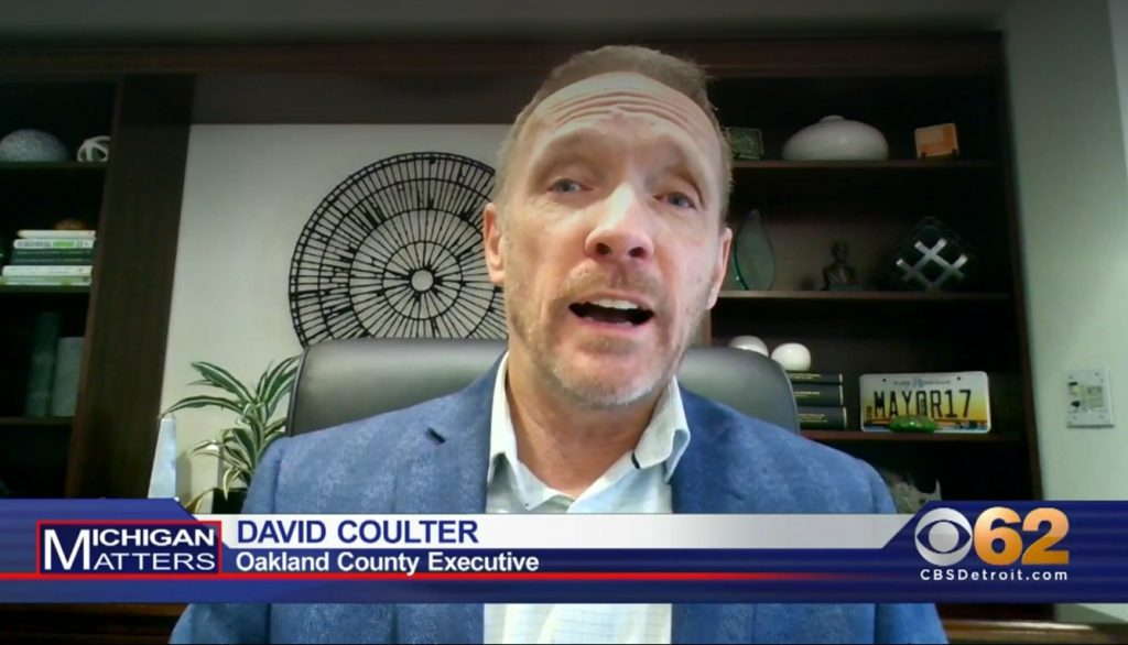 Oakland County Executive Dave Coulter shown from his office speaking on the CBS 62 TV program Michigan Matters.